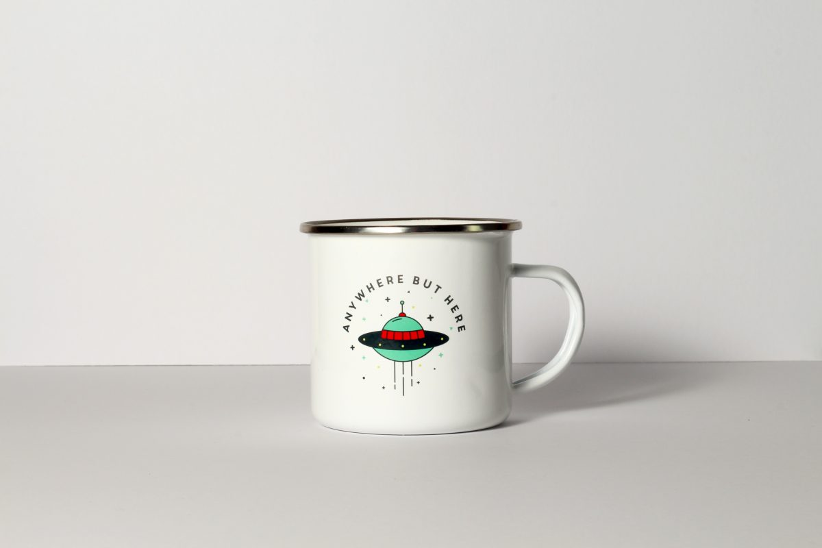 Space Themed Enamel Mug with the slogan 'anywhere but here'
